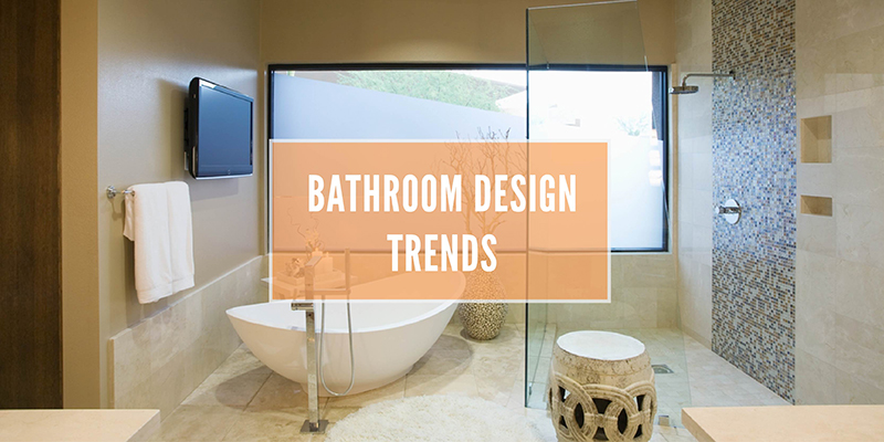 Bathroom design trends in white text over a background of a bathroom with a big white tub