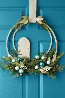 Blue and green ornament wreath on a blue door