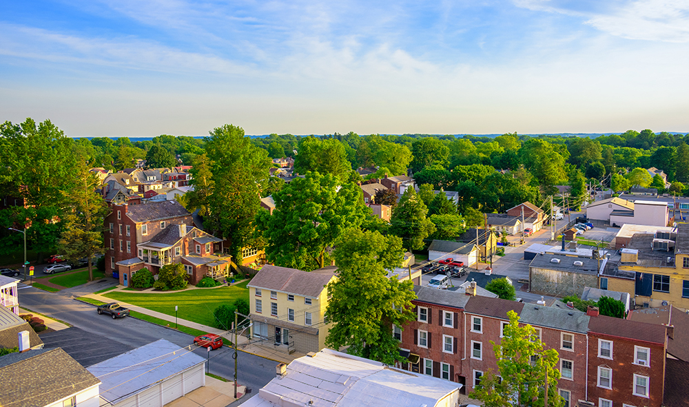 Aerial view of suburban houses and sunset sky - West Chester, Pe